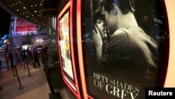 "A film poster for ""Fifty Shades of Grey"" is pictured at Regal Theater in Los Angeles, California, Feb. 12, 2015."