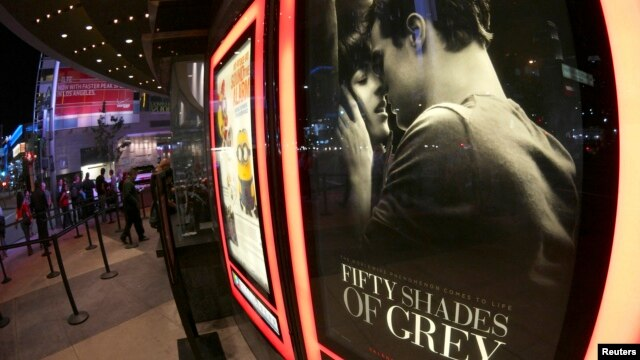 """A film poster for """"Fifty Shades of Grey"""" is pictured at Regal Theater in Los Angeles, California, Feb. 12, 2015."""