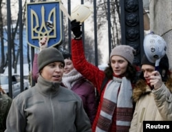 Activists protest in front of Ukraine's Defense Ministry, campaigning for women to be granted more active management and combat roles in the Ukrainian military's conflict with pro-Russian separatists in east Ukraine, in Kiev, Jan. 21, 2016.