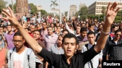 Cairo university students and members of the Muslim Brotherhood shout slogans against the military, in front of Cairo University in Cairo, Oct. 8, 2013.