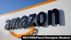 FILE PHOTO: The logo of Amazon is seen at the company logistics center in Boves, France, on August 8, 2018. (REUTERS/Pascal Rossignol)
