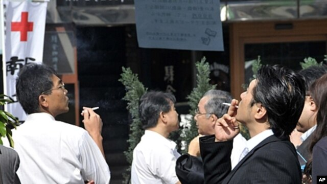 Smokers in Japan flock to stock up on cigarettes, even by stealing them, or struggling to kick the habit ahead of a record tobacco price increase, (File).