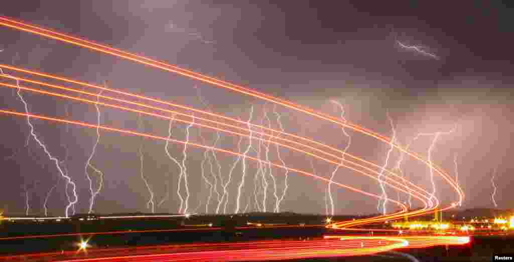 Mass lightning bolts illuminate the night sky by the Daggett airport as storms pass over the high deserts north of Barstow, California.