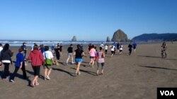 Cannon Beach's landmark Haystack Rock provided a backdrop for the tsunami prep fun run. VOA / T. Banse