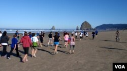 Cannon Beach's landmark Haystack Rock provided a backdrop for the tsunami prep fun run. VOA / T. Banse