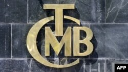A picture taken on Aug. 14, 2018 shows the logo of Turkey's Central Bank (TCMB) at the entrance of the bank's headquarters in Ankara, Turkey.