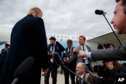 President Donald Trump listens to a question about the missing Saudi journalist Jamal Khashoggi after landing at Cincinnati Municipal Lunken Airport, Oct. 12, 2018, in Cincinnati, Ohio