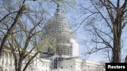 FILE - The U.S. Capitol building, currently under renovation, is seen in Washington April 11, 2015.