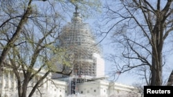FILE - The U.S. Capitol dome, currently under restoration, is seen in Washington April 11, 2015.