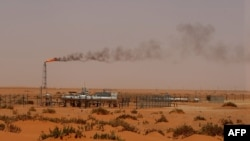 """FILE - A Saudi Aramco oil installion known as """"Pump 3"""" in the desert near the oil-rich area of Khouris, 160 km east of the Saudi capital Riyadh, is seen in a June 23, 2008, photo."""