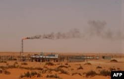 "FILE - A Saudi Aramco oil installion known as ""Pump 3"" in the desert near the oil-rich area of Khouris, 160 km east of the Saudi capital Riyadh."
