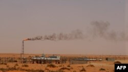 "FILE - A Saudi Aramco oil installation known as ""Pump 3"" in the desert near the oil-rich area of Khouris, 160 km east of the Saudi capital Riyadh, June 23, 2008."
