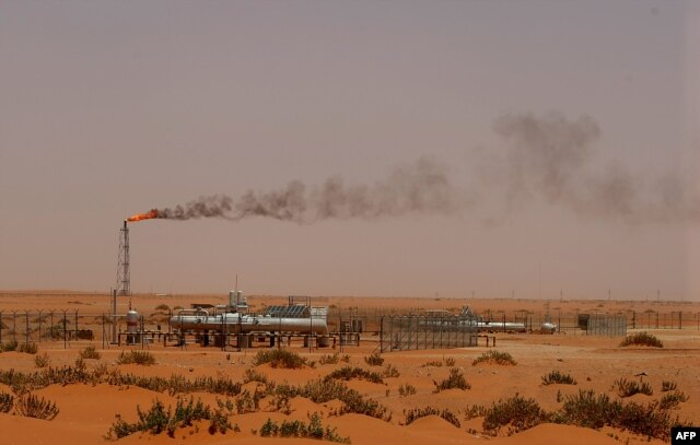 "FILE - A Saudi Aramco oil installion known as ""Pump 3"" in the desert near the oil-rich area of Khouris, 160 km east of the Saudi capital Riyadh."