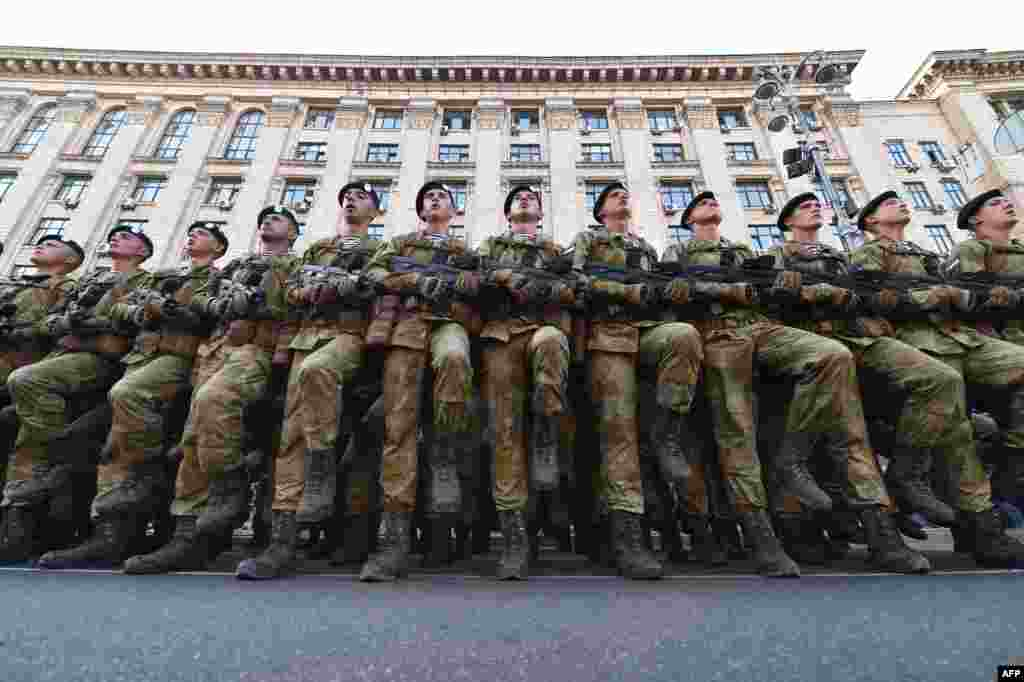 Ukrainian servicemen take part in military parade rehearsal in the center of Kyiv. Ukraine will mark the 25th anniversary of its Independence on Aug. 24.