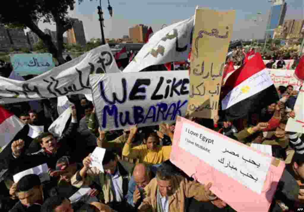 Supporters of Egyptian President Hosni Mubarak shout slogans during a march in Cairo, Egypt, Tuesday, Feb. 1, 2011. Egyptian authorities battled to save President Hosni Mubarak's regime with a series of concessions and promises to protesters, but realitie
