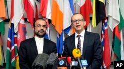 Iran's Ambassador to the IAEA, Reza Najafi (L) and IAEA Deputy Director General, Head of the Department of Safeguards, Tero Tapio Varjoranta talk to the media in Vienna, Austria, Oct. 29, 2013.