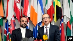 Iran's Ambassador to the IAEA, Reza Najafi, left, and IAEA Deputy Director General and Head of the Department of Safeguards, Tero Tapio Varjoranta, International Center, Vienna, Oct. 29, 2013.