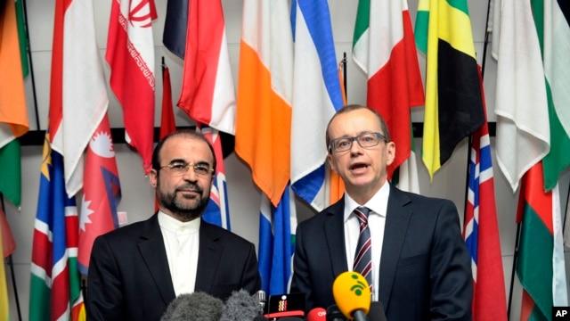 Iran's Ambassador to the IAEA, Reza Najafi, left, and IAEA Deputy Director General and Head of the Department of Safeguards, Tero Tapio Varjoranta, International Center, Vienna, Oct. 29, 2013.