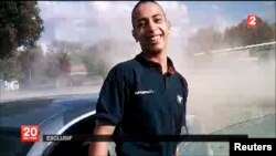 An undated frame grab from a France 2 video broadcast on March 21, 2012, which reportedly shows Mohamed Merah, the suspect in the 2012 killings of 3 paratroopers, 3 children and a rabbi in France.