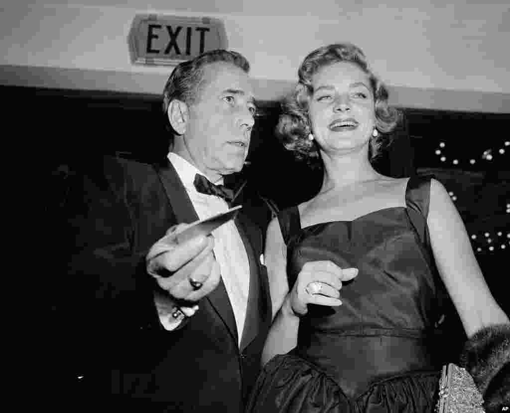 Humphrey Bogart arrives with his wife, Lauren Bacall, for the Hollywood premiere 'The Desperate Hours', Oct. 12, 1955.