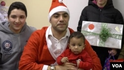 Mahmoud Mahmoud, the director of the Church World Service office in Jersey City, New Jersey, played Santa for a gathering of nearly 40 refugee children.