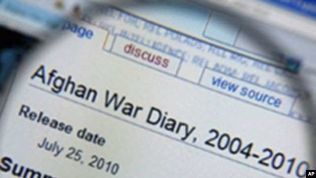 A magnifying glass held in front of a computer screen, displaying an Afghan War Diary on the Wikileaks website, 26 July 2010