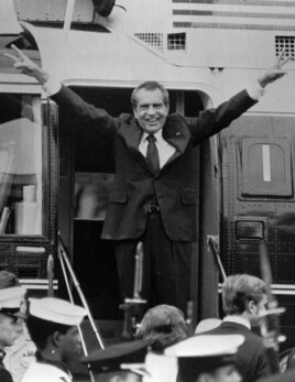 In this Aug. 9, 1974, file photo, Richard Nixon says goodbye to members of his staff outside the White House in Washington as he boards a helicopter for Andrews Air Force Base after resigning the presidency in Washington.