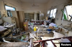 FILE - Damage is seen inside a hospital operated by Medecins Sans Frontieres after it was hit by a Saudi-led coalition air strike in the Abs district of Hajja province, Yemen, Aug. 16, 2016.