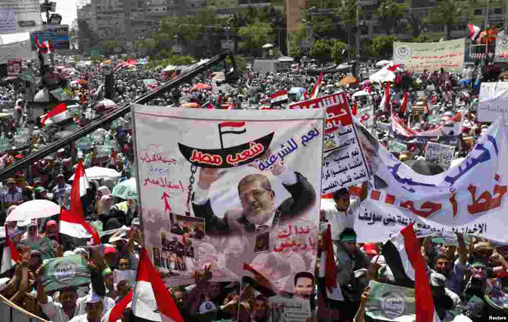 Islamists, members of the brotherhood, and supporters of Egyptian President Mohamed Morsi, shout slogans during a protest around the Raba El-Adwyia mosque square in the suburb of Nasr City, Cairo, June 28, 2013.