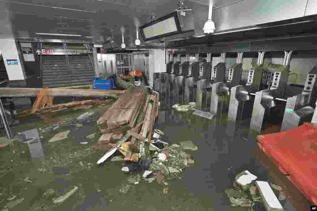 This photo provided by the Metropolitan Transportation Authority shows the South Ferry subway station after it was flooded by seawater during superstorm Sandy on Oct. 30, 2012.