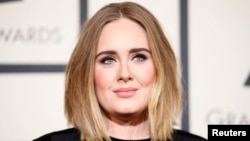 FILE - Singer Adele arrives at the 58th Grammy Awards in Los Angeles, California, Feb. 15, 2016.