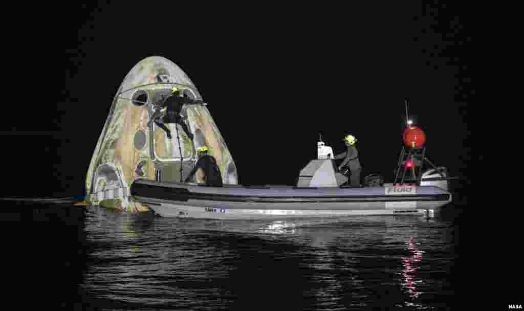 Support teams work around the SpaceX Crew Dragon Resilience spacecraft shortly after it landed with NASA astronauts Mike Hopkins, Shannon Walker, and Victor Glover, and Japan Aerospace Exploration Agency (JAXA) astronaut Soichi Noguchi aboard in the Gulf of Mexico off the coast of Panama City, Florida.