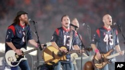 FILE - This Oct. 9, 2014 file photo shows The Eli Young Band performing during halftime of an NFL football game in Houston. The band will perform as part of the Concert in Your Car series at the new Texas Rangers stadium in Arlington, Texas starting June June 4. (AP Photo)
