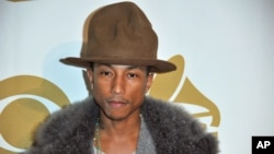 "Pharrell Williams arrives at ""The Night That Changed America: a Grammy Salute to the Beatles, "" Jan. 27, 2014, in Los Angeles"