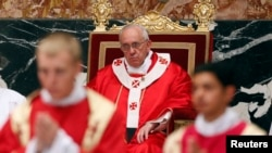 Pope Francis celebrates a mass for cardinals and bishops who died in the past year, in St. Peter's Basilica at the Vatican, Nov. 4, 2013.