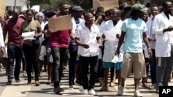 FILE: A group of Zimbabwean doctors protest at Parirenyatwa Hospital in Harare, Zimbabwe, Sunday, Sept. 15, 2019.