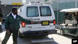 A prisoner transport van believed to be carrying pop star Justin Bieber arrives at the Turner Guilford Knight Correctional Center, Jan. 13, 2014, in Miami.