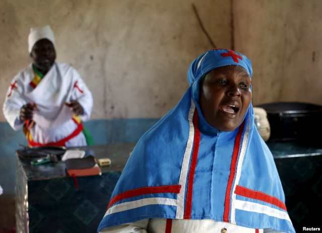 A woman sings during an Easter Sunday service in a church in Garissa, Kenya, April 5, 2015.