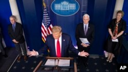 President Donald Trump speaks about the coronavirus accompanied by Dr. Anthony Fauci, left, director of the National Institute of Allergy and Infectious Diseases, Vice President Mike Pence, and Dr. Deborah Birx, White House coronavirus response…