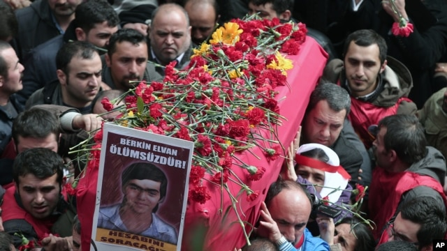People carry the coffin of Berkin Elvan, a Turkish teenager who was in a coma since being hit on the head by a tear gas canister fired by police during  anti-government protests in the summer of 2013, during his funeral in Istanbul, Turkey, March 12, 2014