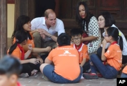 Britain's Prince William, Duke of Cambridge, talks with pupils as he visits a local primary school in downtown Hanoi, Vietnam, Nov. 16, 2016.