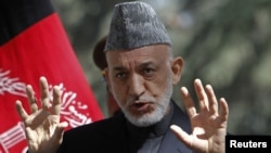 Afghanistan's President Hamid Karzai speaks during a news conference in Kabul, October 4, 2012.