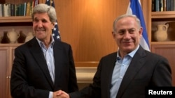 Secretary Kerry shakes hands with Prime Minister Netanyahu during a meeting in Jerusalem on June 27, 2013.