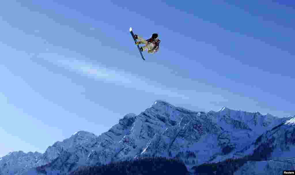 U.S. snowboarder Ryan Stassel takes air off a jump during slopestyle snowboard training at the 2014 Sochi Winter Olympics, Feb. 4, 2014.