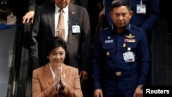 FILE - Thailand's Prime Minister Yingluck Shinawatra after a defense meeting in Bangkok March 4, 2014.