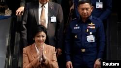 Thủ tướng Thái Lan Yingluck Shinawatra sau khi một cuộc họp quốc phòng tại Bangkok, ngày 4/3/2014.