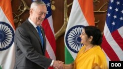 Indian Minister of External Affairs Sushma Swaraj shakes hands with U.S. Defense Secretary James Mattis before the start of the 2+2 meeting at the Ministry of External Affairs in New Delhi, Sept. 6, 2018.