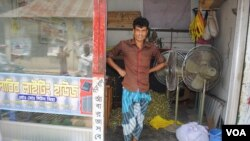 Former garment worker Liton Mia was injured in the collapse of Rana Plaza but today he owns a shop that rents out lights and equipment for weddings. (Amy Yee for VOA News)