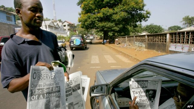A man checks headlines of Sierra Leonean newspapers in Freetown. File photo.