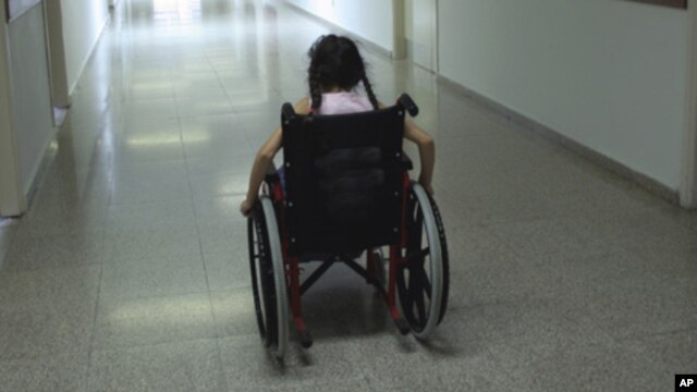 FILE - A U.N. report says disaster planning often neglects to take those with disabilities in mind.